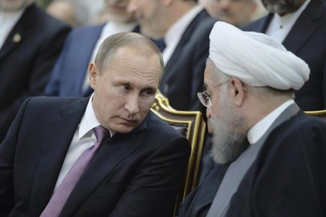 Russian President Vladimir Putin and his Iranian counterpart Hassan Rouhani attend a signing ceremony in Tehran. IBP